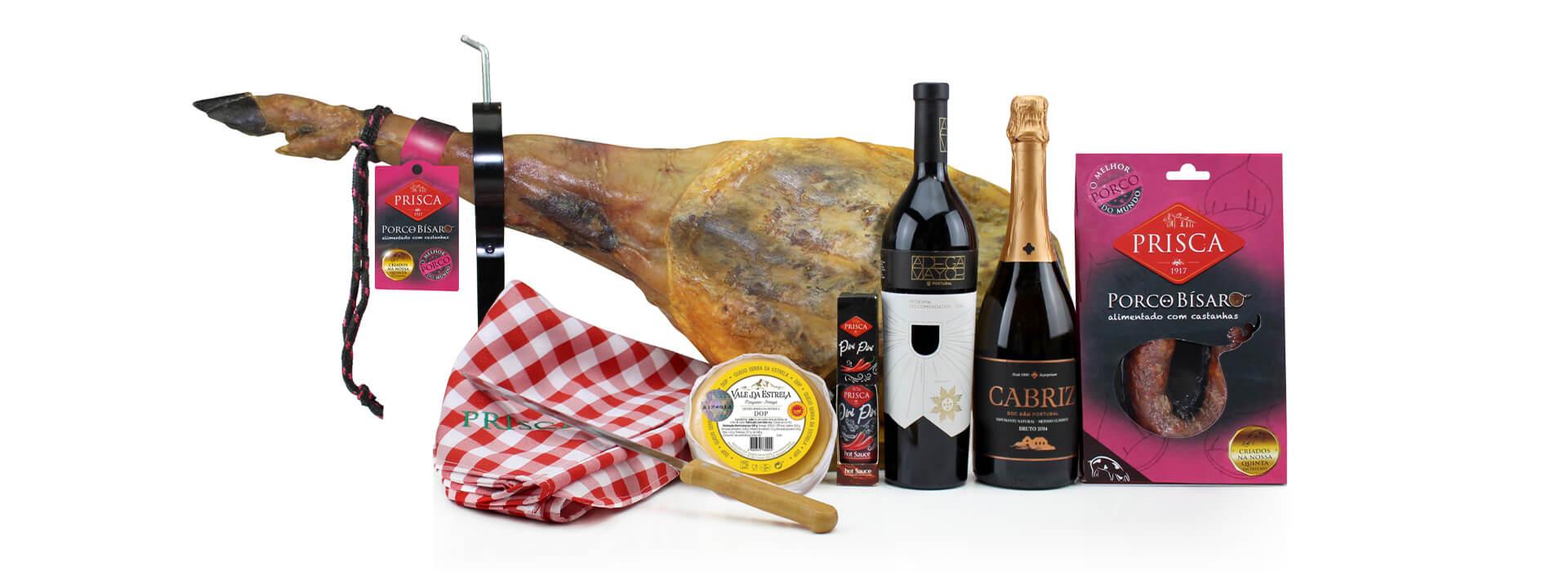 Cabaz Sabores da Terra 2 com produtos bísaros, queijos de ovelha amanteiagado D.O.P espumante Cabriz e Reserva do Comendador Tinto.